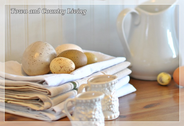 White linens, fresh eggs, and ironstone pitchers