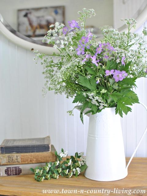 Wildflowers in an enamel pitcher