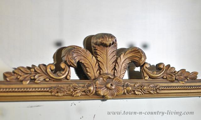 Scroll work on a vintage mirror