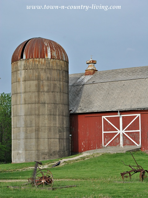 Silo on a Rustic Red Barn