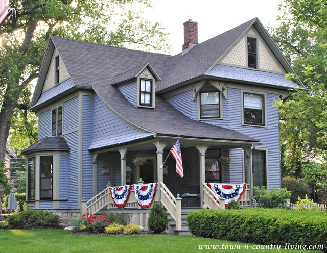 Victorian home with patriotic porch