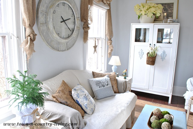 Family room with burlap curtain swags