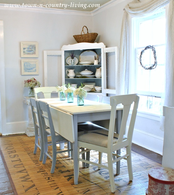 Cottage style dining room with white walls