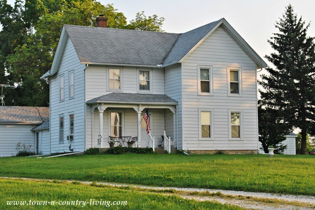 White Farmhouse via Town and Country Living