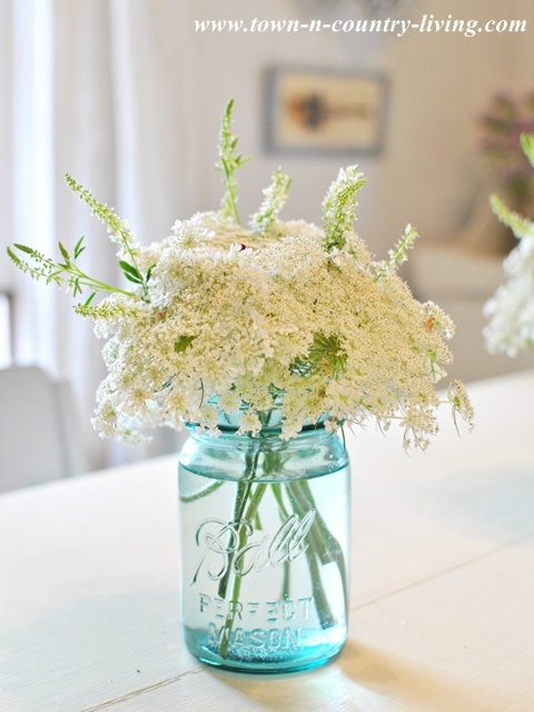 Queen Anne's Lace in a Blue mason jar via Town and Country Living