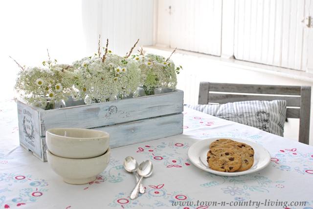 Vintage tablecloth creates cottage style breakfast nook