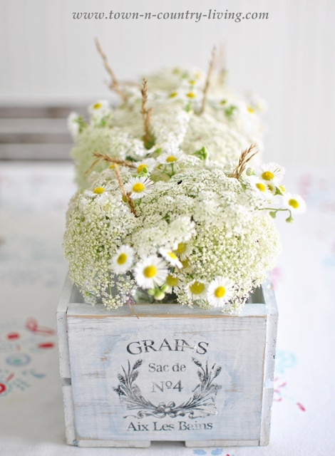 French crate filled with cottage style flowers