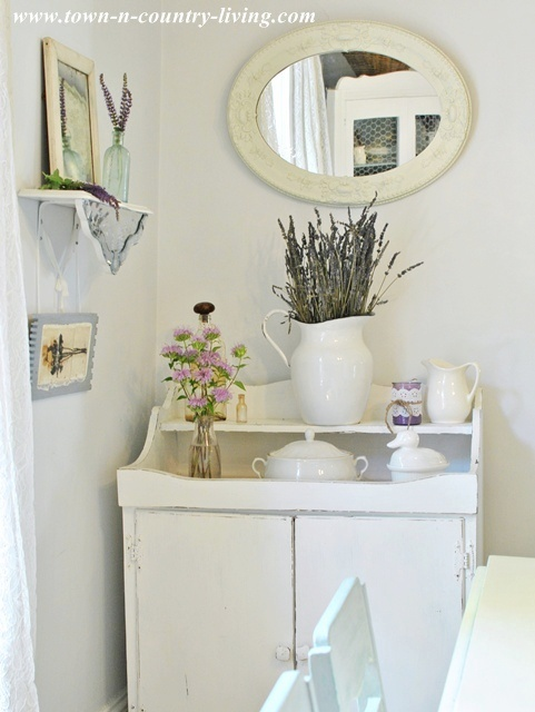 Farmhouse dry sink with white ironstone and enamelware via Town and Country Living