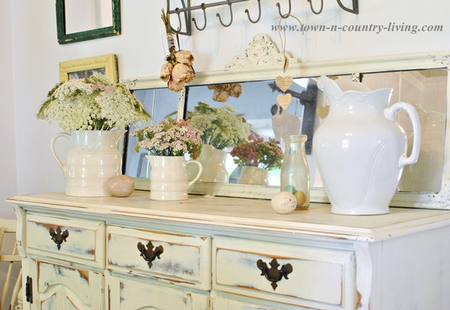 Summer Wildflowers in White Ironstone Pitchers via Town and Country Living