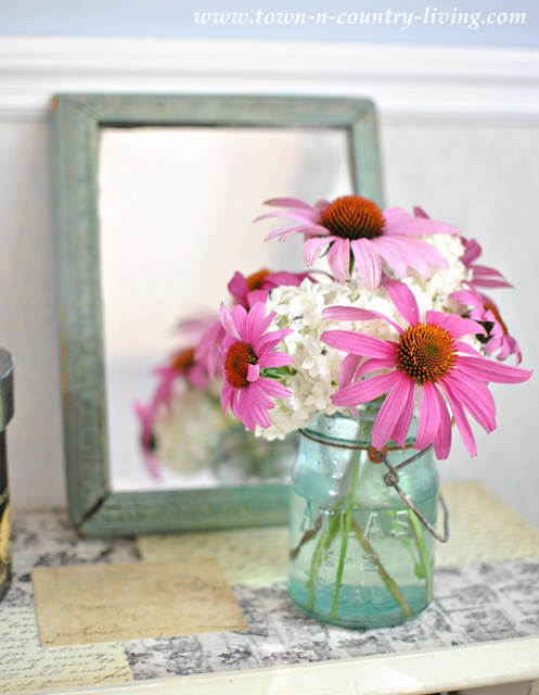 Cottage Style flowers in a blue mason jar via Town and Country Living