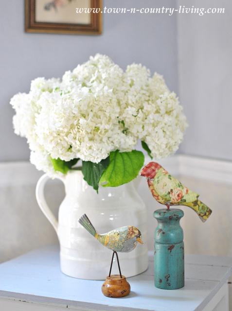 White hydrangeas in a white ironstone pitcher via Town and Country Living