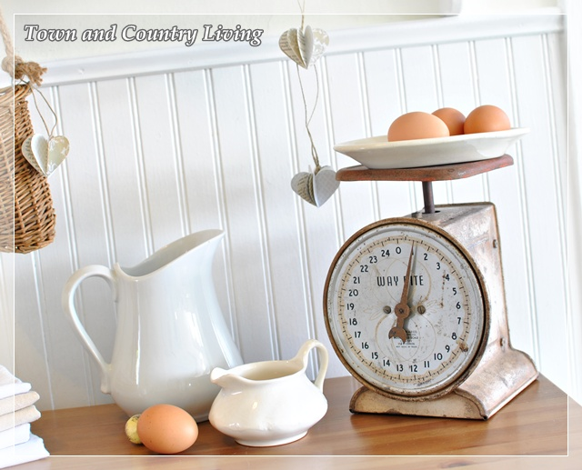 French weight scale and white ironstone via Town and Country Living