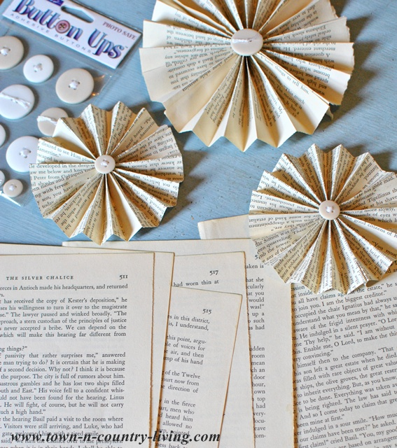 Materials to make a book page fan garland via Town and Country Living
