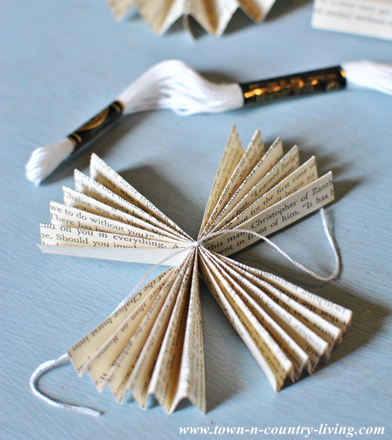 How to make a paper fan garland via Town and Country Living