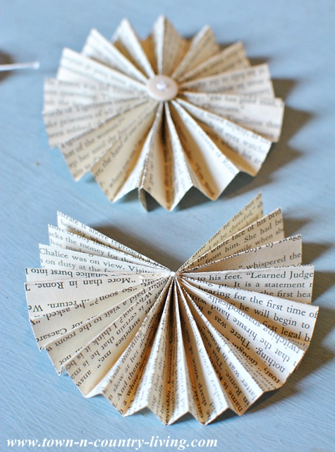 Making paper fans for decorative garland via Town and Country Living
