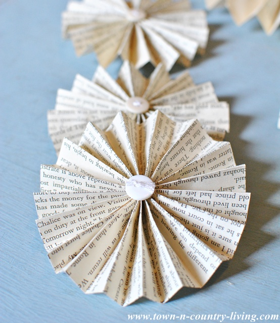 How to make book page fans for paper garland via Town and Country Living