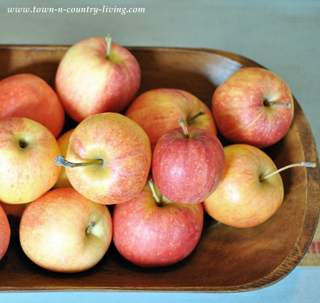 Gala apples in a wooden bowl via Town and Country Living