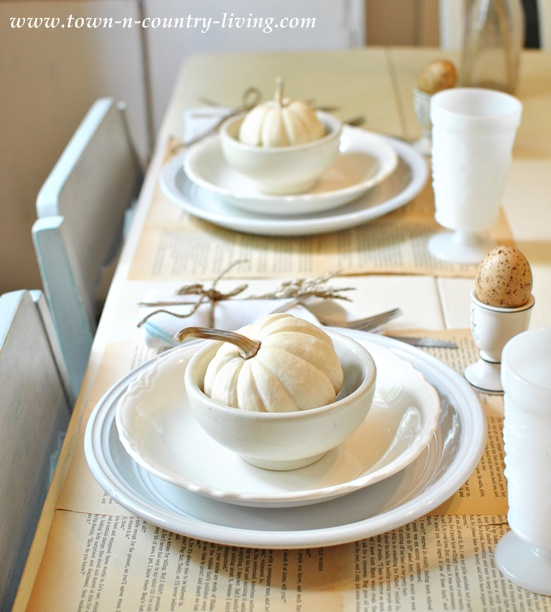Book page placemats at a Fall table setting via Town and Country Living