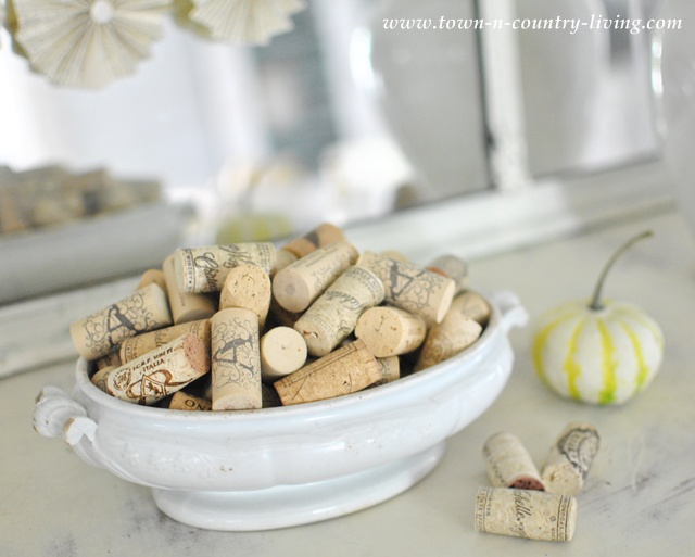 White ironstone tureen filled with wine corks via Town and Country Living