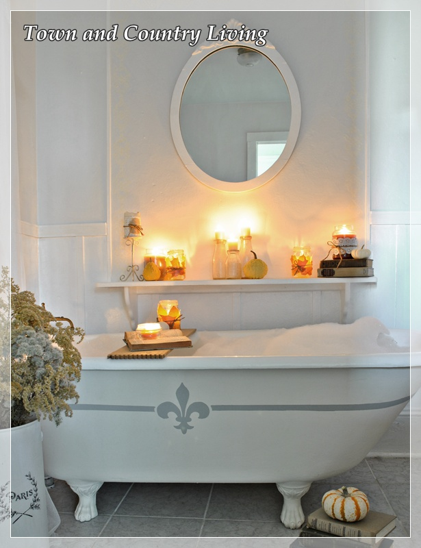 Claw foot tub decorated for Fall via Town and Country Living