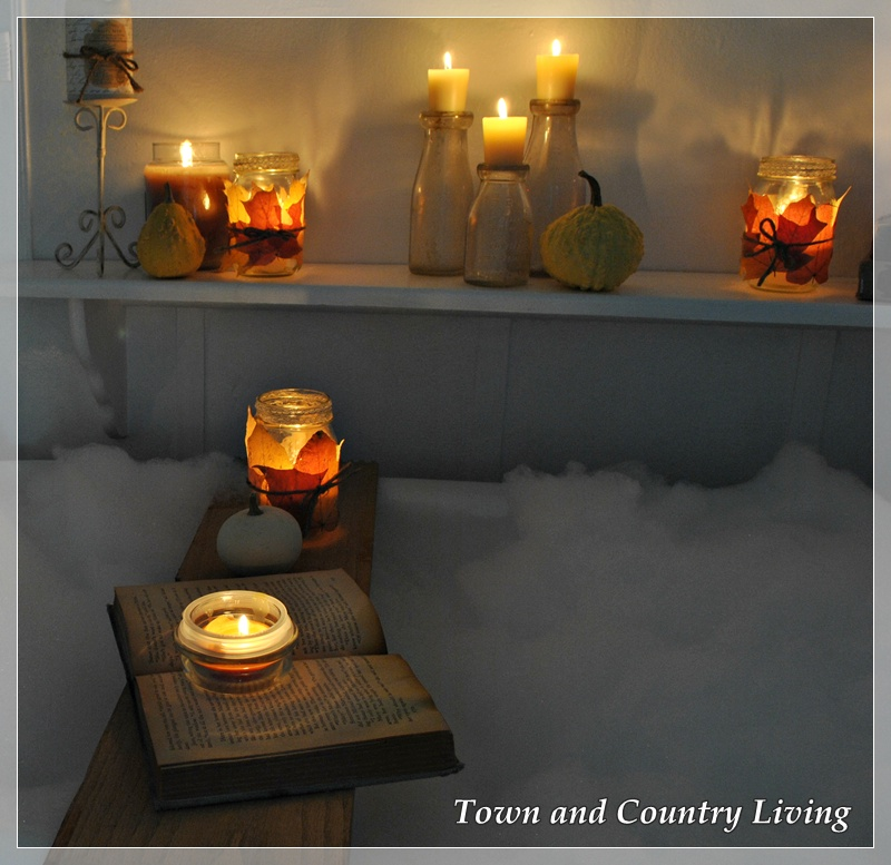 Candlelit bubble bath in a claw foot tub via Town and Country Living
