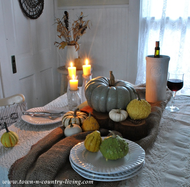 Fall Decorating with Candles and Gourds via Town and Country Living