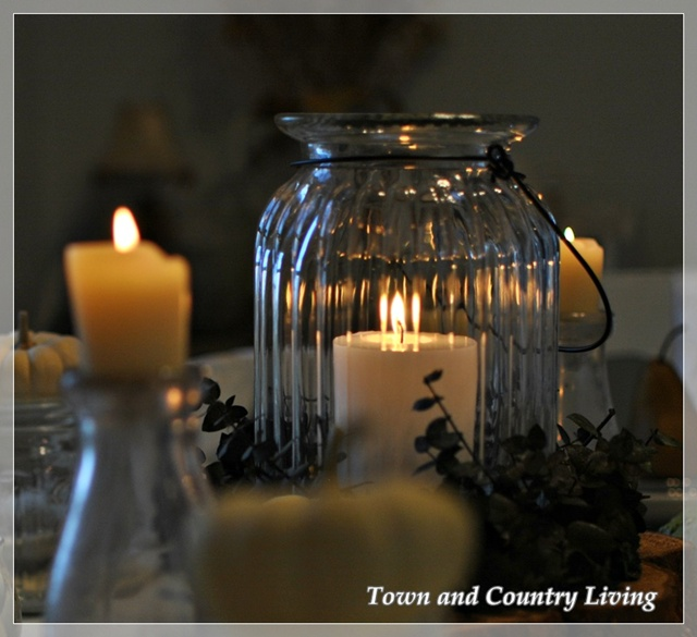 Glass jars and candles via Town and Country Living