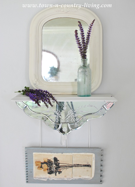 Vintage mirror vignette via Town and Country Living