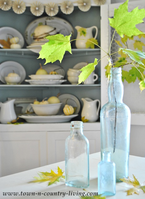 Vintage aqua bottle dressed for Fall via Town and Country Living