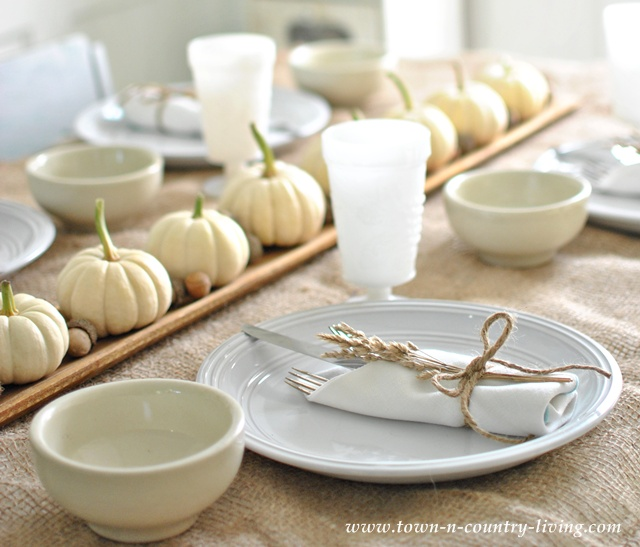 Baby Boo pumpkins used as Autumn centerpiece via Town and Country Living