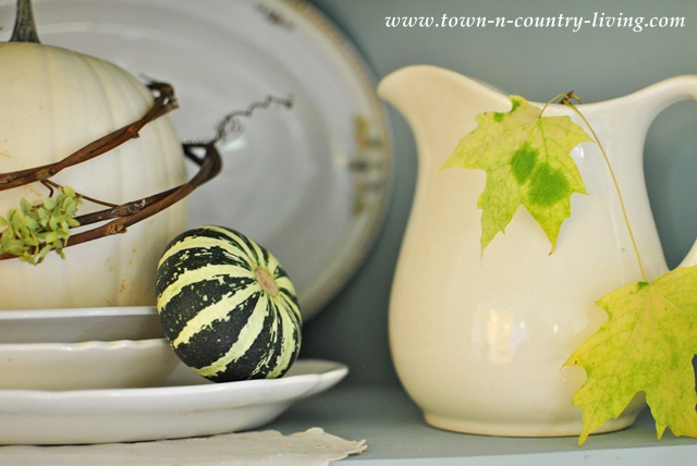 White ironstone decorated for Fall via Town and Country Living