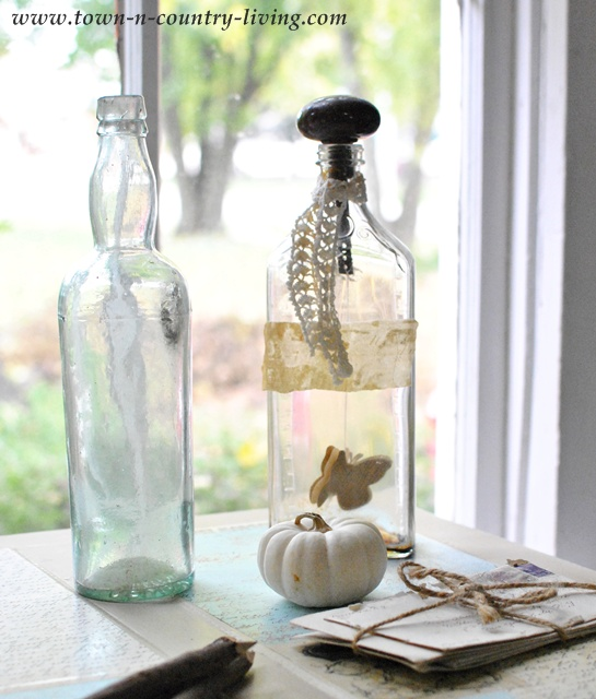 Vintage Bottles via Town and Country Living