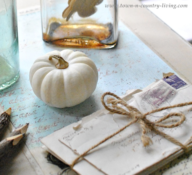 Vintage Letters on a Decoupaged Desk via Town and Country Living