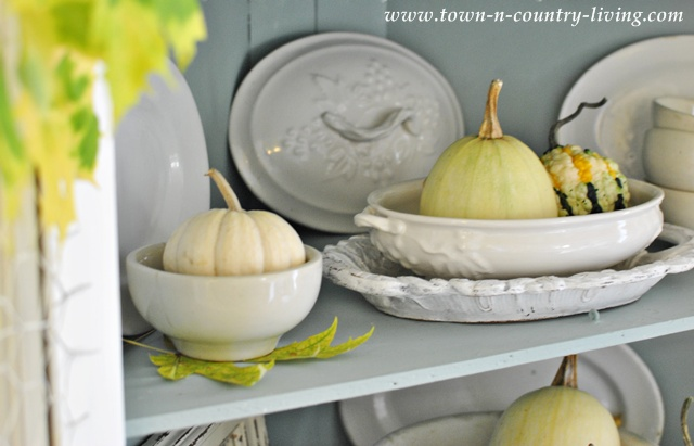White ironstone in a farmhouse Fall hutch via Town and Country Living