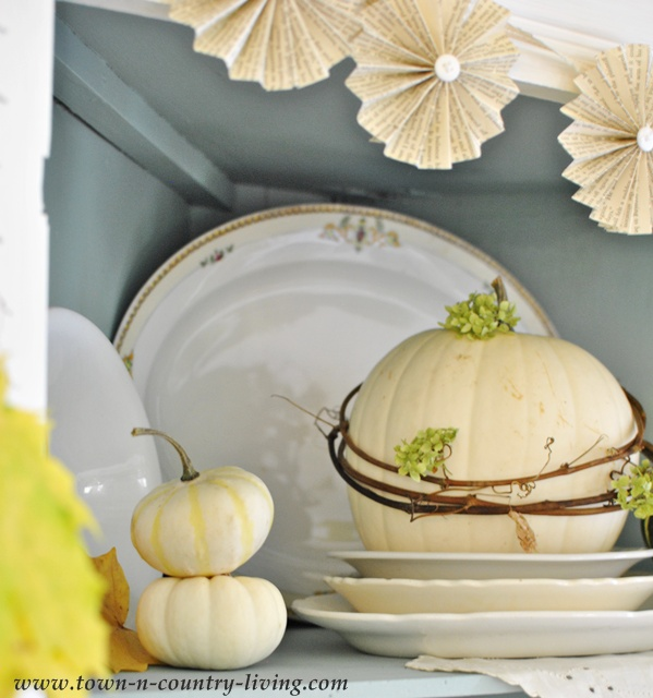 Fall hutch with white ironstone and gourds via Town and Country Living