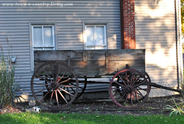 Wagon as landscape decor via Town and Country Living