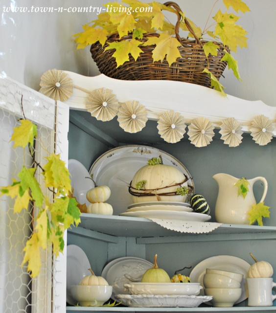 Farmhouse hutch decorated for Fall via Town and Country Living