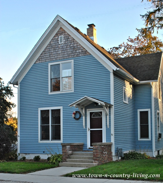 Blue clapboard house via Town and Country Living