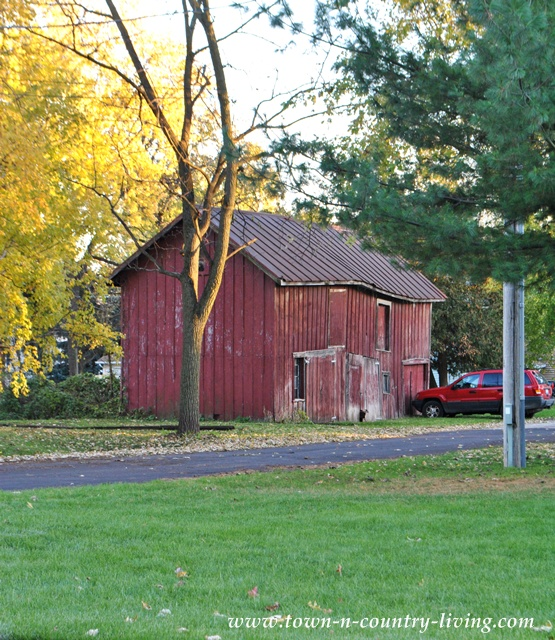 Red dilapidated barn via Town and Country Living