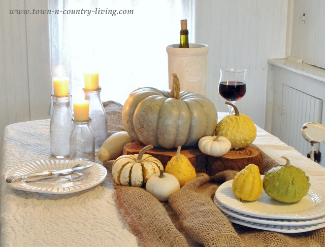 Autumn centerpiece in a farmhouse kitchen via Town and Country Living