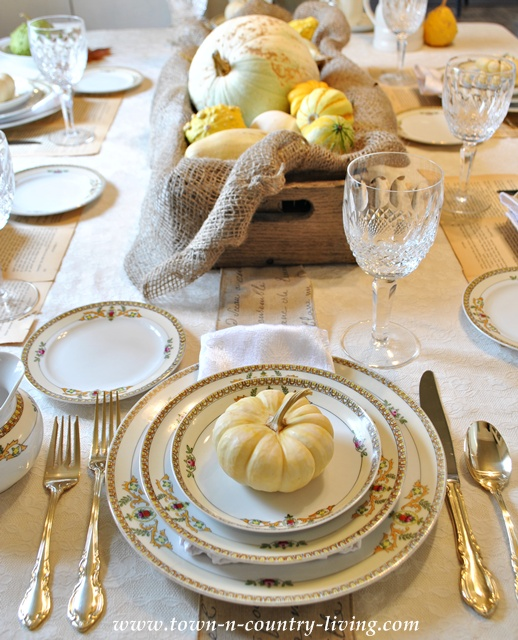 Baby Boo in an Autumn table setting via Town and Country Living