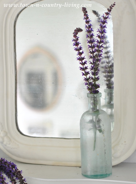 Purple sage in vintage aqua bottle via Town and Country Living