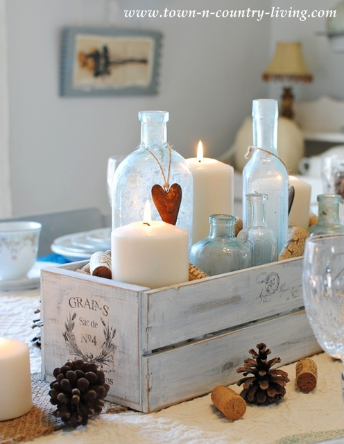 Aqua Bottles in a Thanksgiving Centerpiece via Town and Country Living