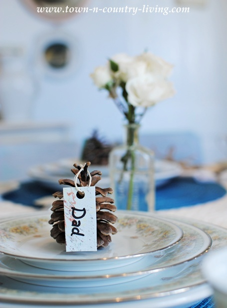Acorn place cards for Thanksgiving table setting via Town and Country Living