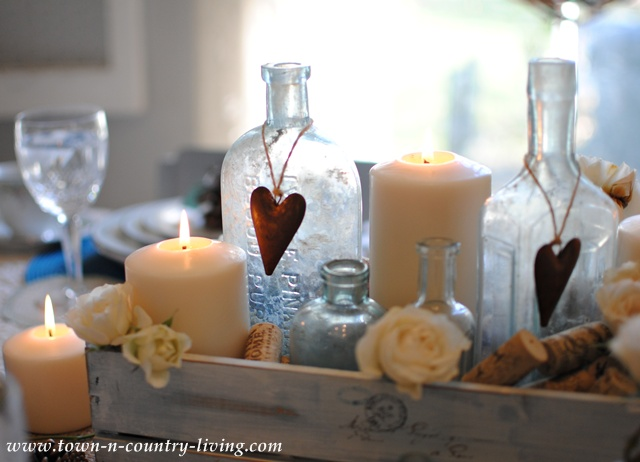 Vintage aqua bottles and candle centerpiece