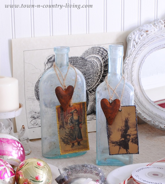 Aqua bottles decorated for Christmas via Town and Country Living