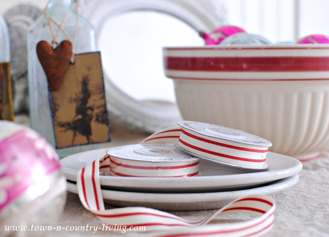 Red and white Christmas ribbon via Town and Country Living