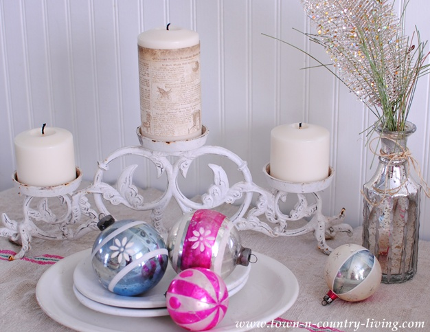 Shabby chic wrought iron candelabra via Town and Country Living