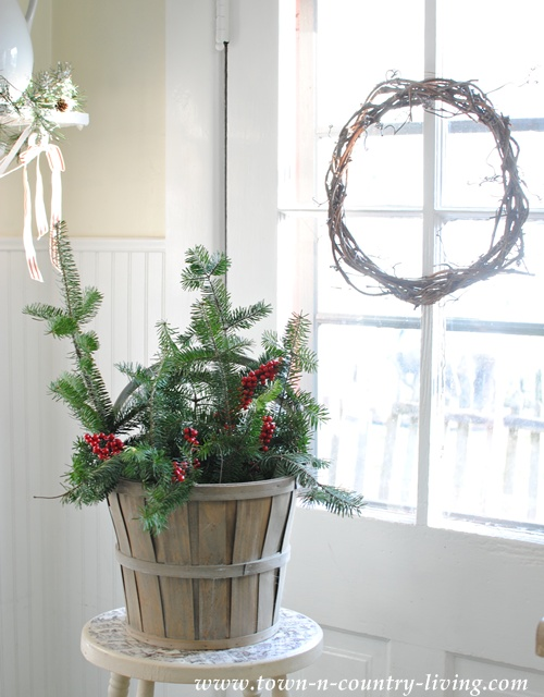 Christmas Greenery Basket via Town and Country Living