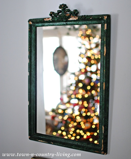 Reflections of Christmas in a chippy green mirror